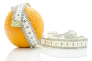 Orange fruit wrapped with measuring tape